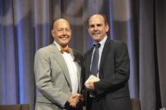 Dan, and Kevin Mummau of CUSO, accept BISA Career Achievement Awards.
